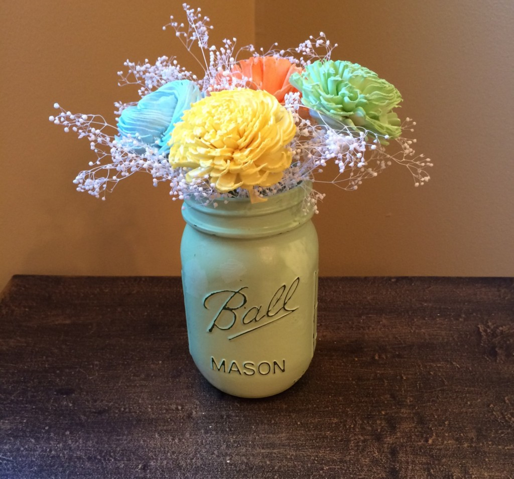 Beautiful Mason Jar centerpiece with Sola flowers.