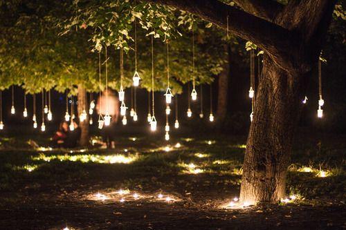 Mason Jar Candles Hanging From Trees